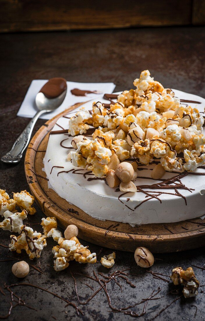 Round macadamia nut nougat with salted honey caramel popcorn and macadamia nuts