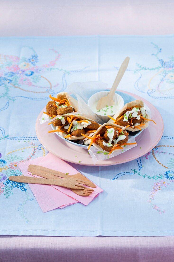 Stuff pita bread with falafel and garlic sauce