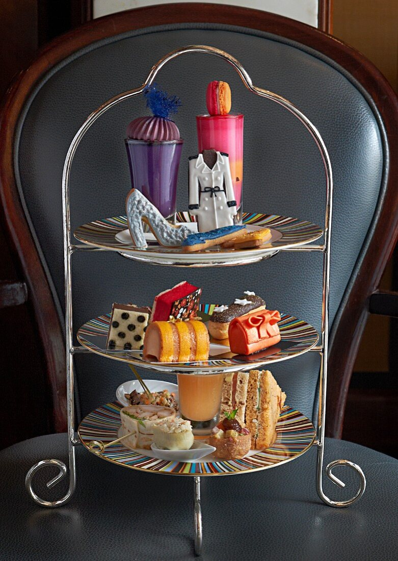 Sandwiches and sweet cakes on a cake stand for teatime