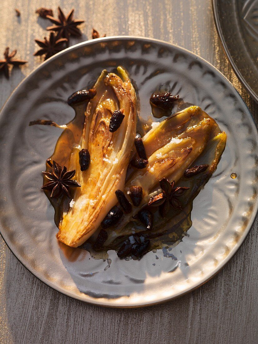 Oriental chicory in butter caramel with tiny morel mushrooms
