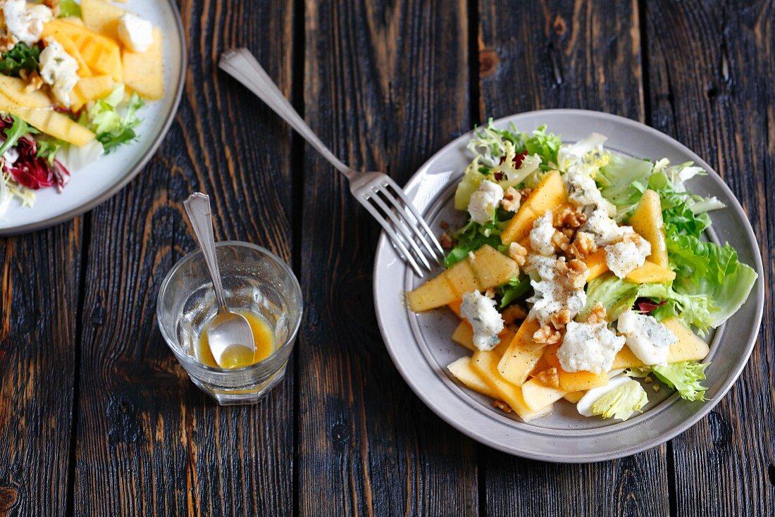 Persimmon salad with gorgonzola, walnuts and a honey-mustard dressing
