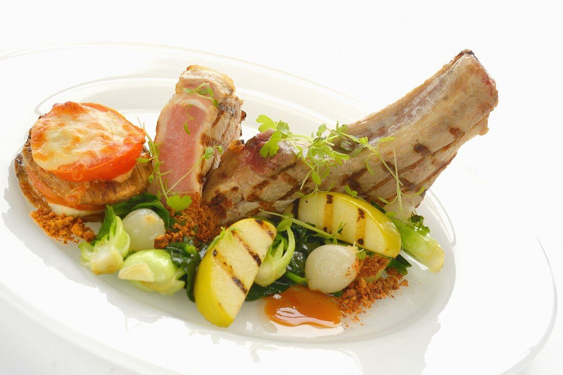 Grilled Kurobuta pork chop with a tomato and aubergine gratin, garlic and grilled apple