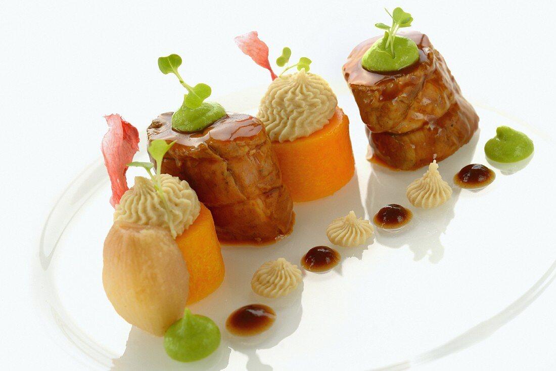 Fried pork fillet with sides of vegetables