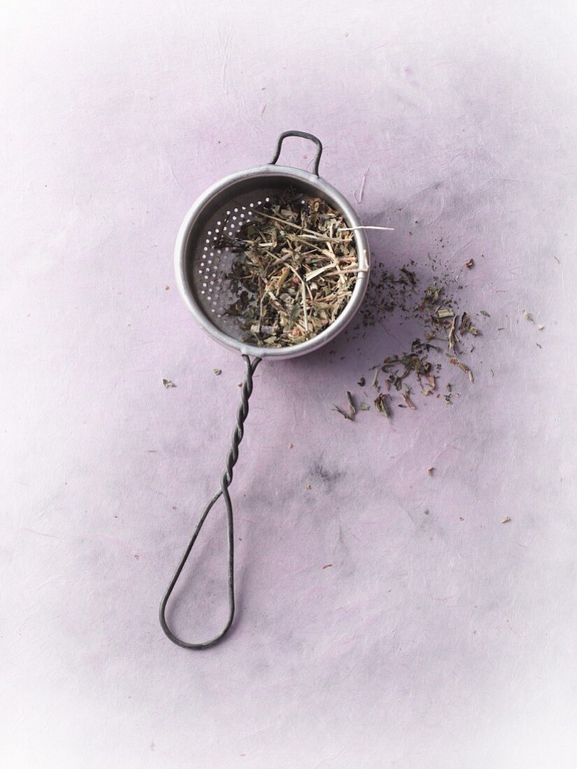 Dried restharrow in a tea strainer