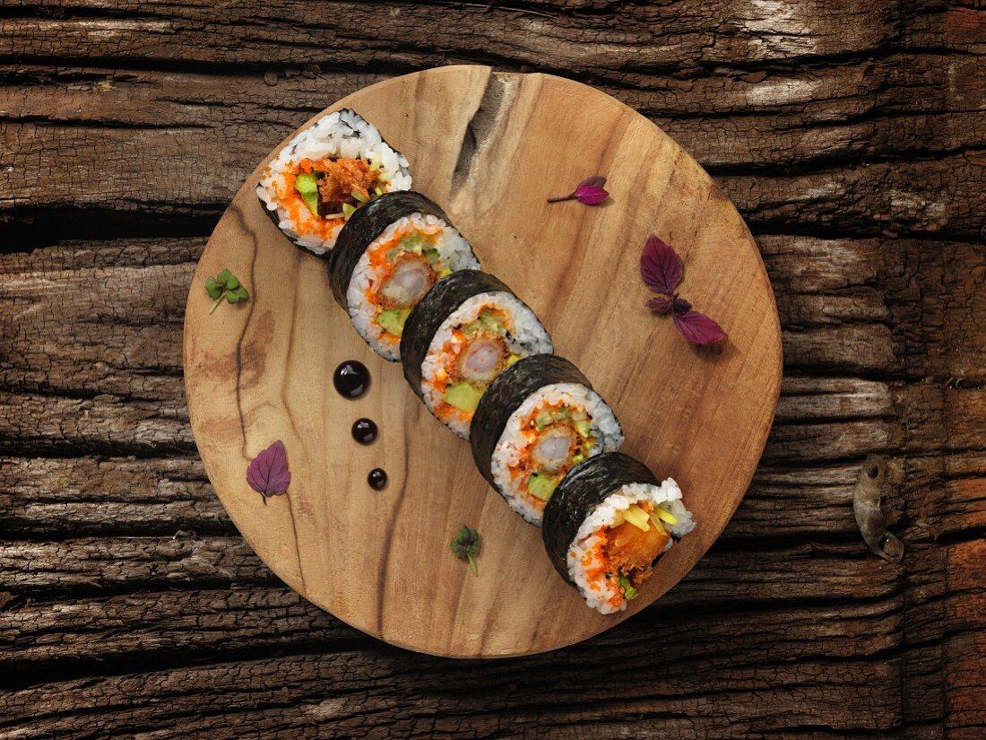 Futomaki sushi with shrimps, caviar and avocado