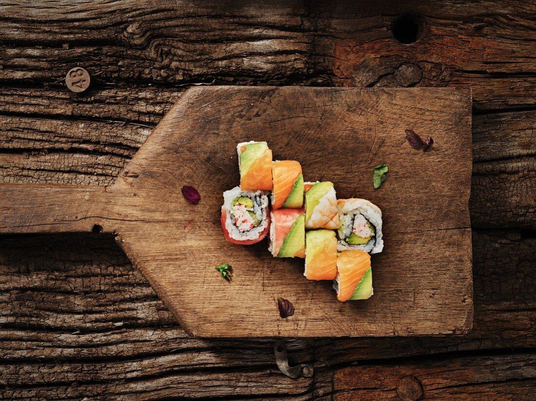 Maki sushi with salmon, avocado and crab