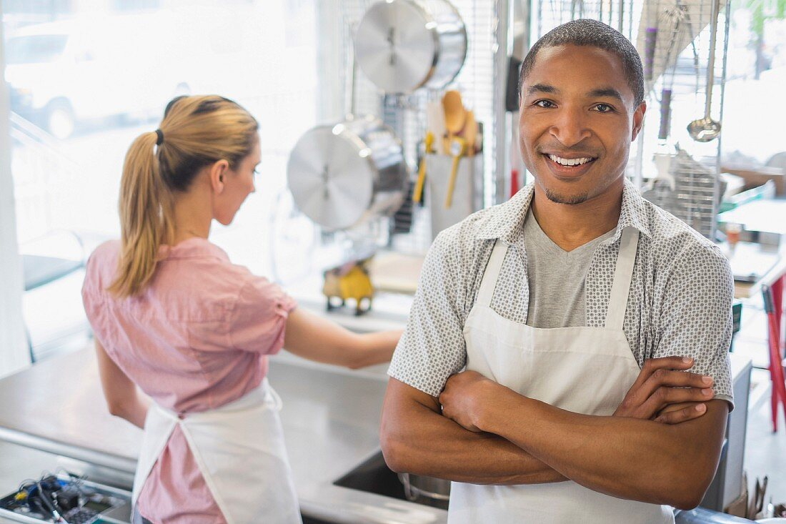 Two people in a commercial kitchen