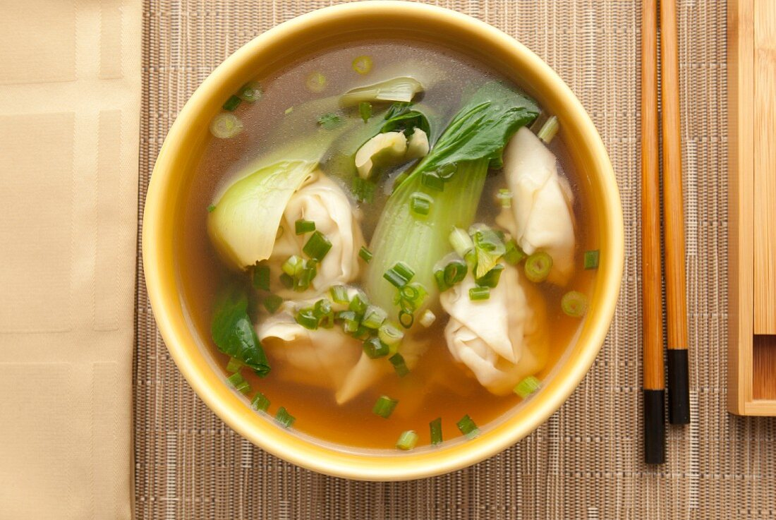 Clear soup with prawn wontons and bok choy