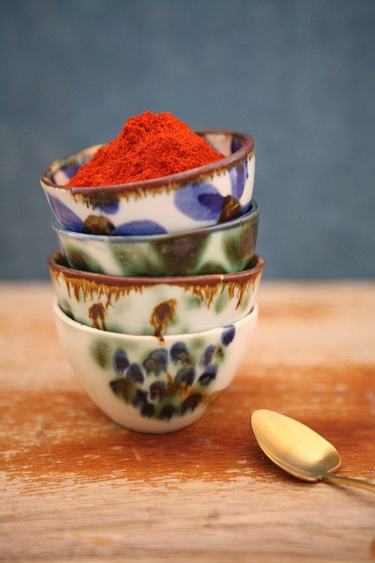 Saffron powder in a stack of ceramic bowls