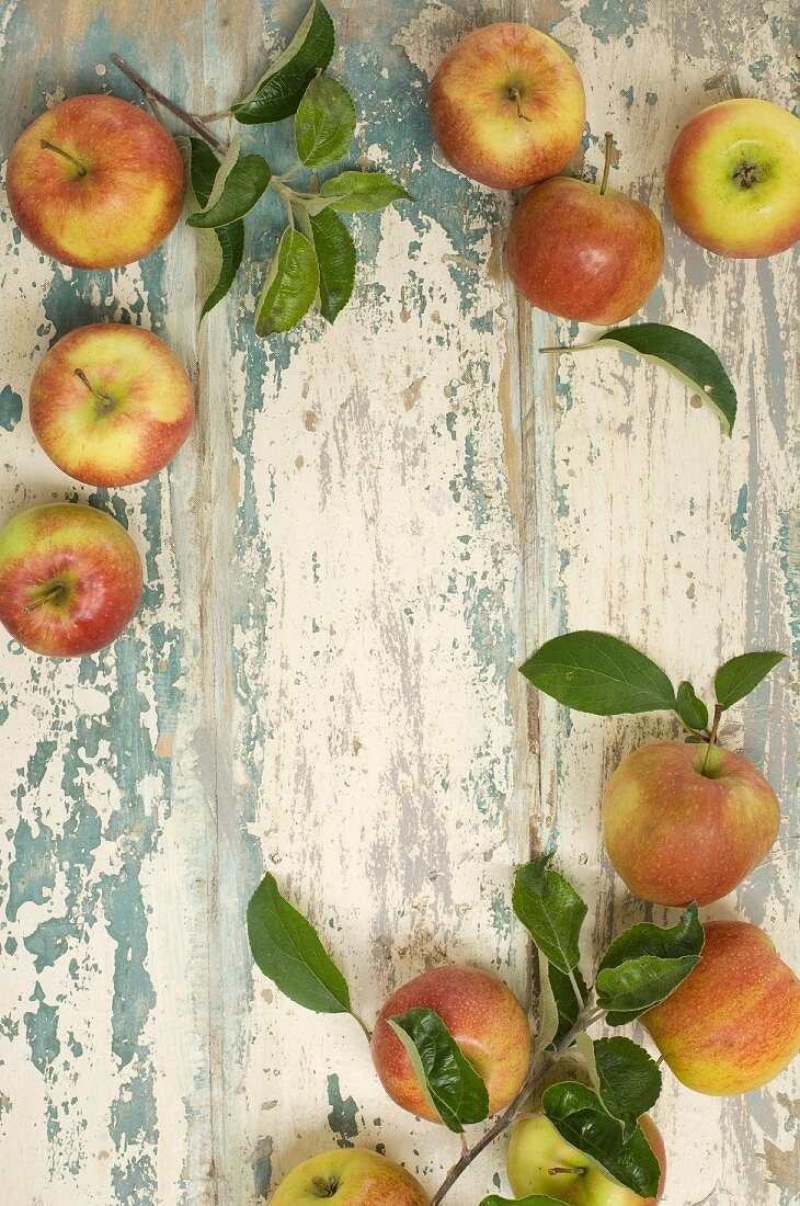 Fresh apples creating a frame on a rustic wooden table (see above)