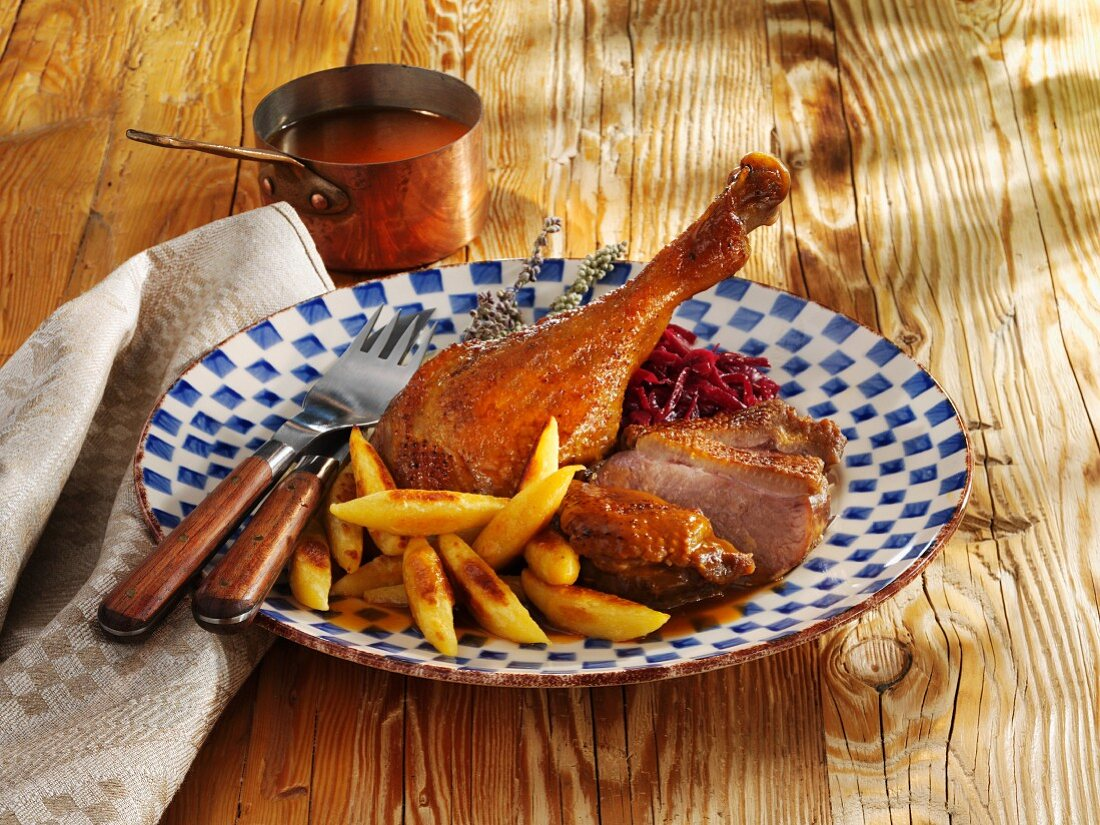 Roast goose with potato orzo pasta and red cabbage