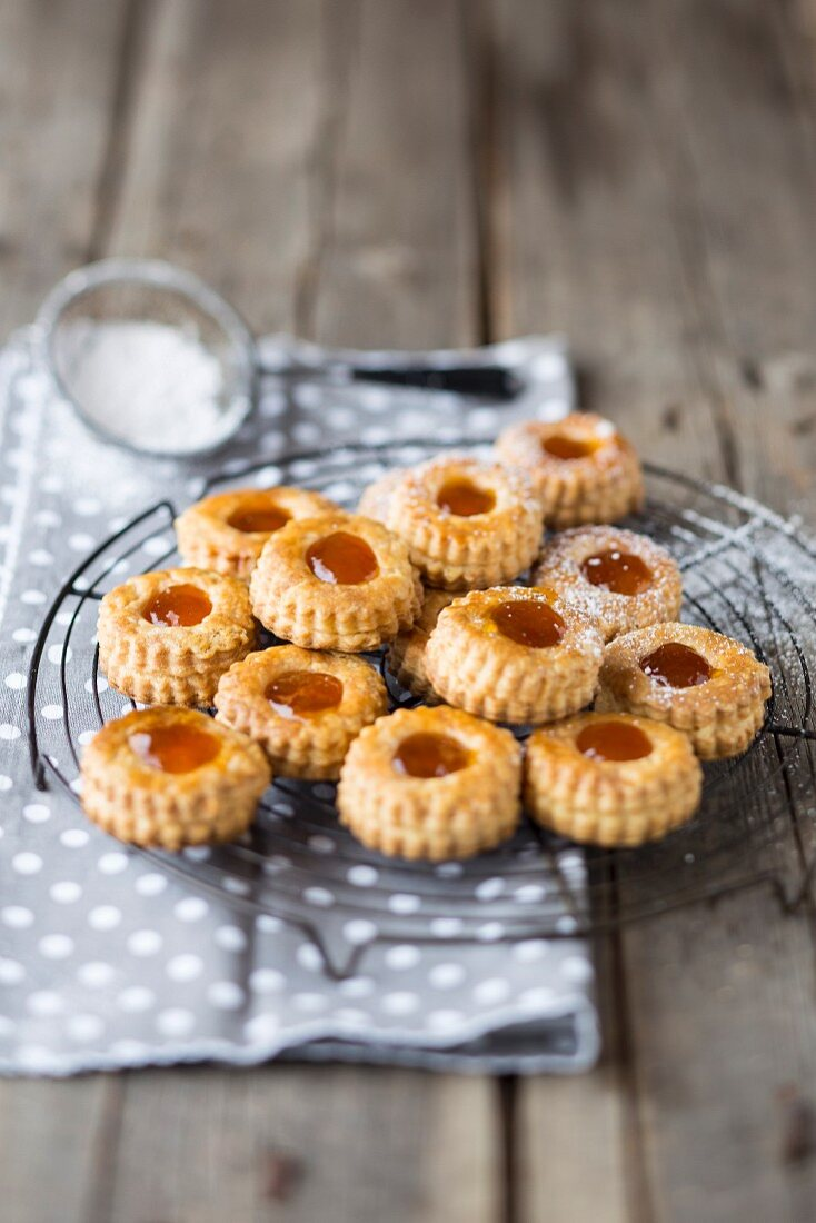 Apricot jam biscuits on a cooling rack
