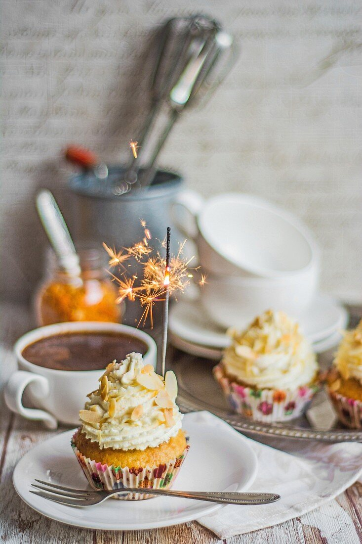 Almond and orange cupcakes with sparklers