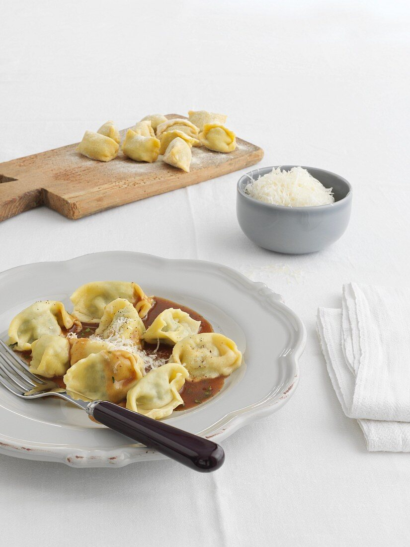 Agnolotti ripieni with sauce and grated cheese