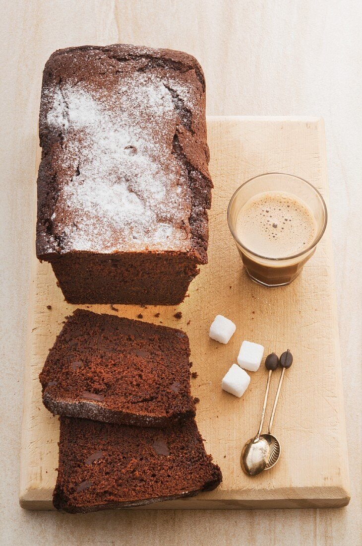 Chocolate cake, sugar lumps and coffee