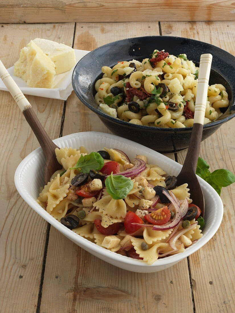 Insalate con fiocchi tigati and insalata con cellentani alla puttanesca (Italian pasta salads)