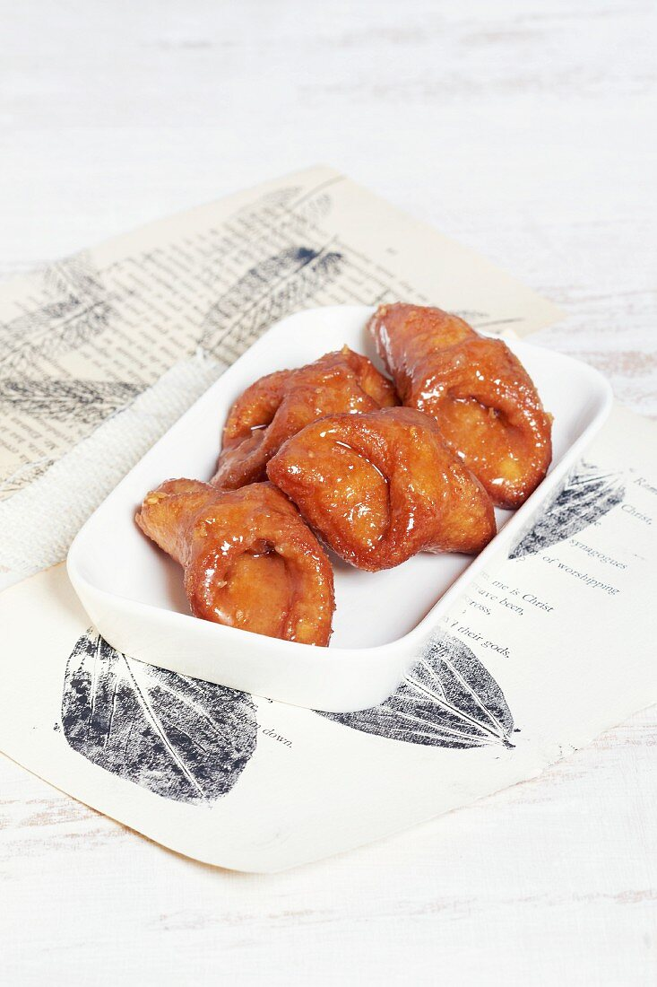 Pestions (deep-fried pastries with honey glaze, Spain)