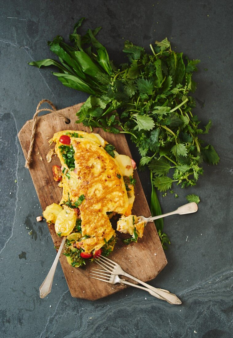 Classic country omelette with potatoes and vegetables