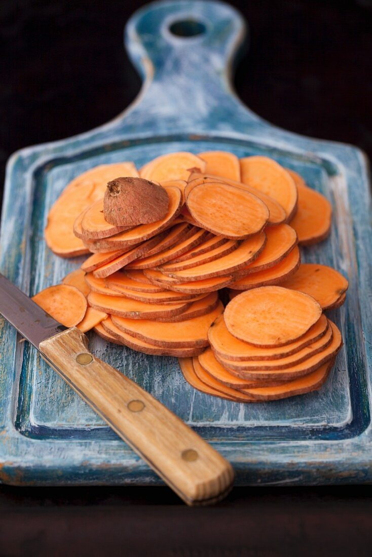 Sweet potato slices on a chopping board