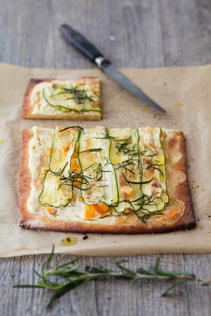 Tarte flambée with goat's cream cheese, courgettes, apricots and rosemary