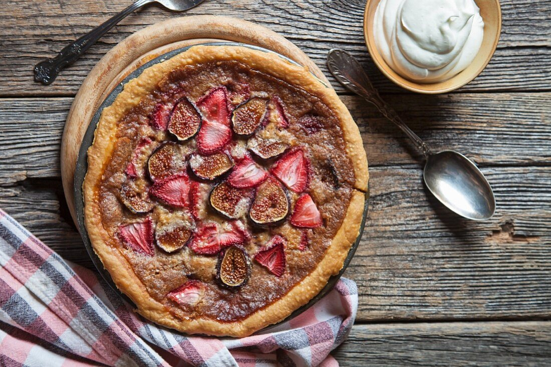 Homemade strawberry and fig tart with whipped cream