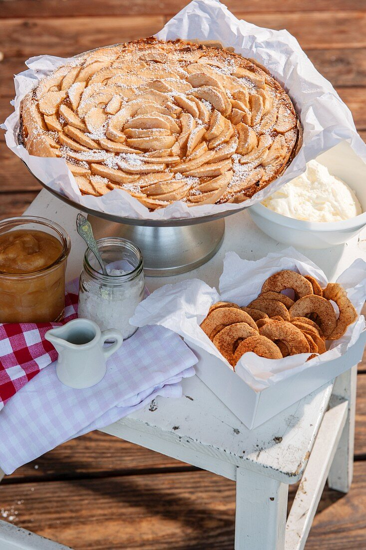 Apple cake, dried apple rings and apple sauce