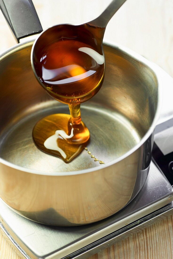 Golden syrup being poured into a pot