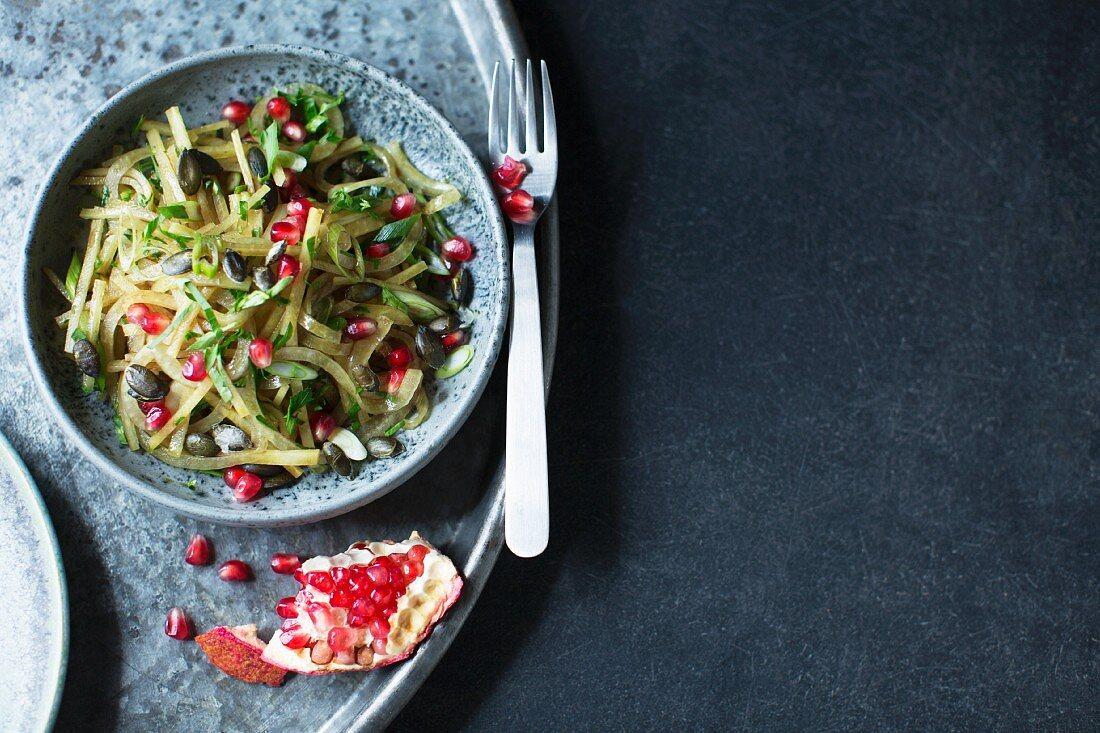 Turnip salad with pomegranate seeds