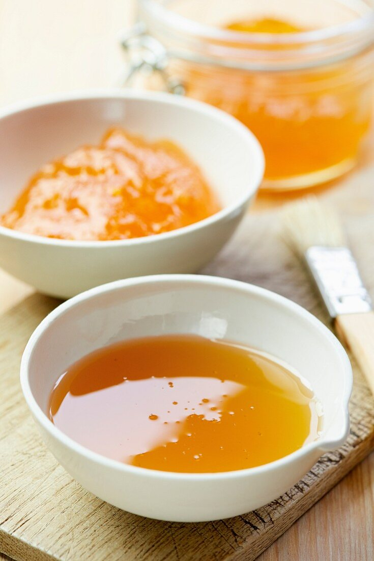 Apricot jam and honey in porcelain bowls