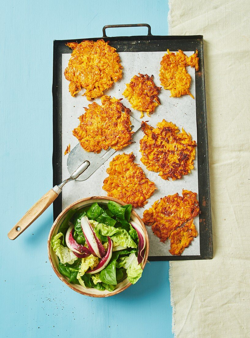 Carrot and pumpkin fritters with a salad
