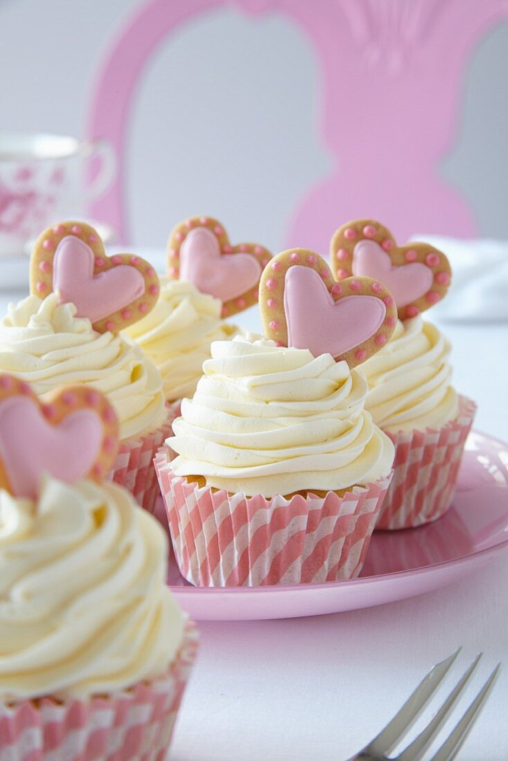 Romantic swirl cupcakes decorated with pink hearts for Valentine's Day