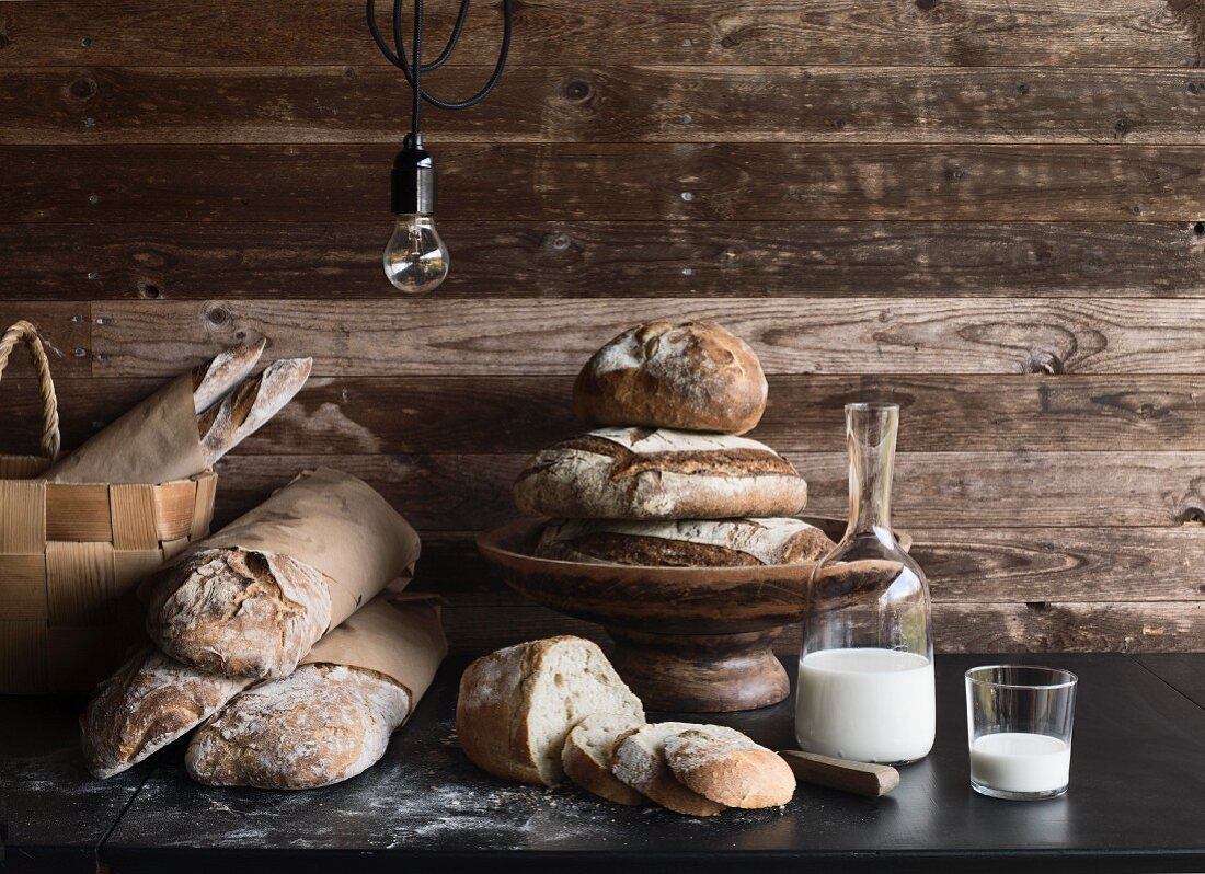 Various loaves of rustic bread with milk