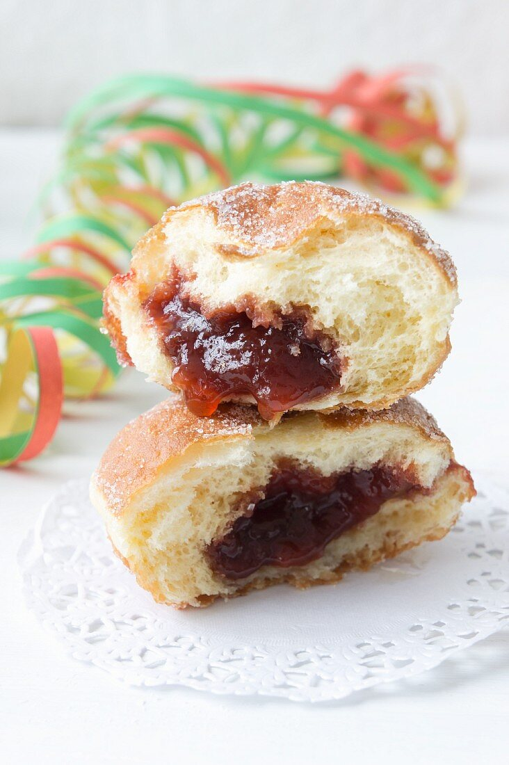 Doughnuts with jam on paper doilies