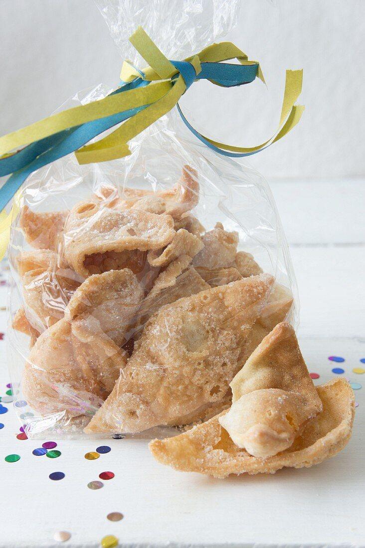 Mutzen (carnival pastries) in a cellophane bag