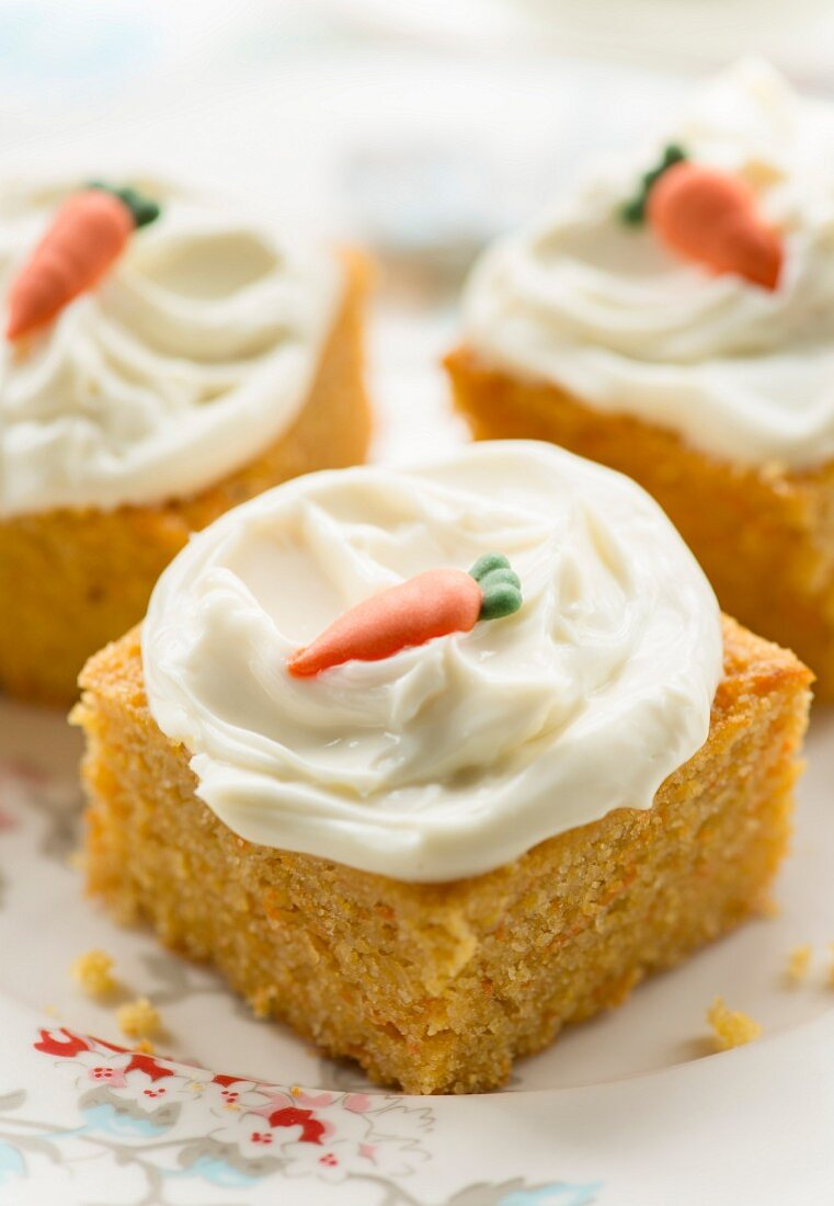 Carrot cake decorated with cream cheese frosting and sugar carrot