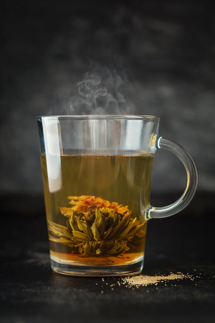 Tea and a tea rose in a glass cup