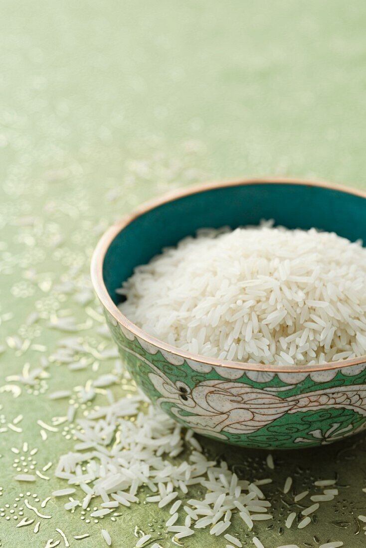 Uncooked basmati rice in an oriental bowl