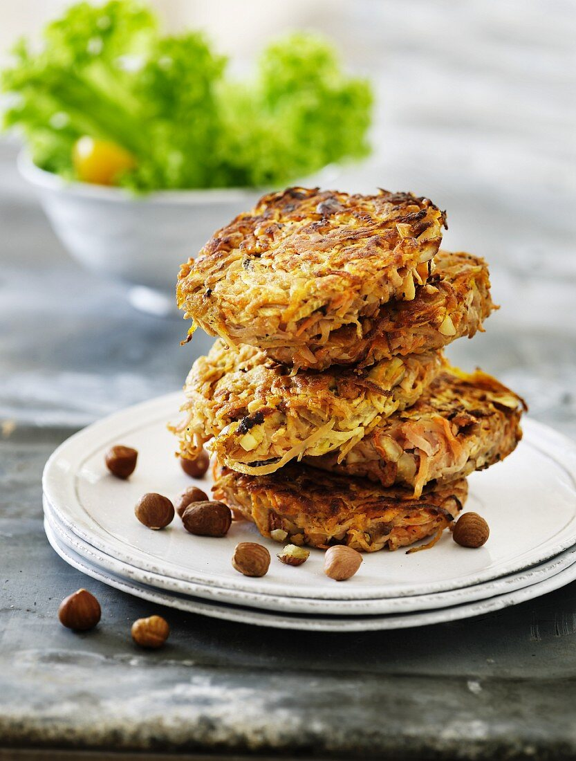 A stack of vegetable cakes with hazelnuts