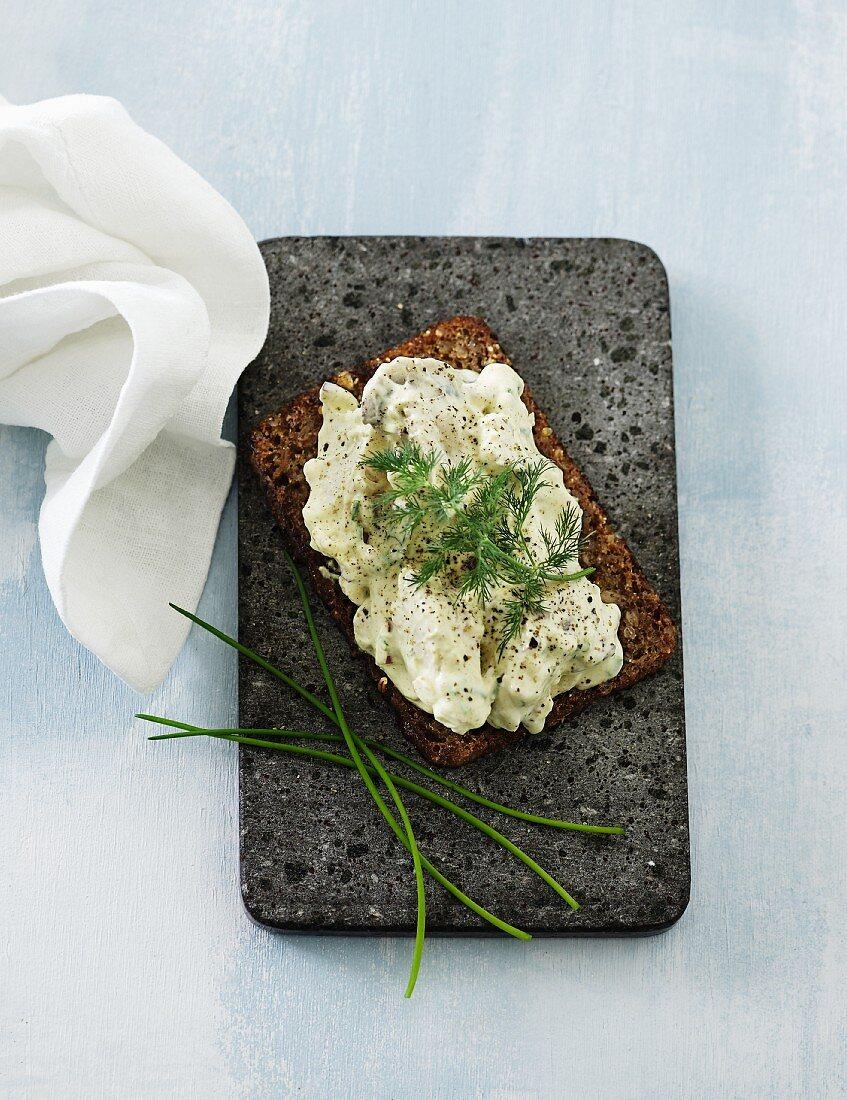Slice of wholemeal bread spread with tuna fish cream