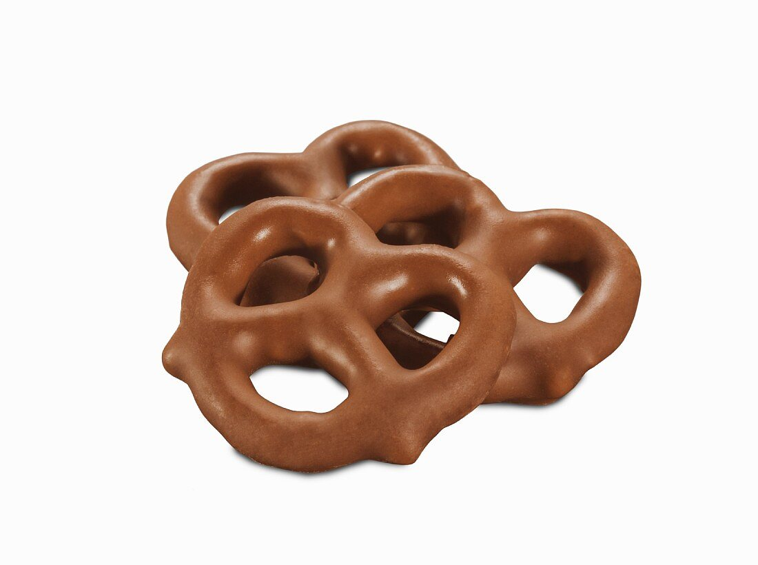 Three milk chocolate pretzels (close-up)