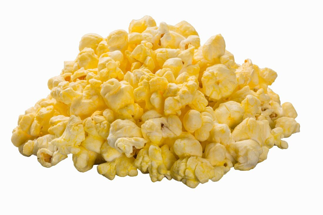 A pile of buttered popcorn on the white surface