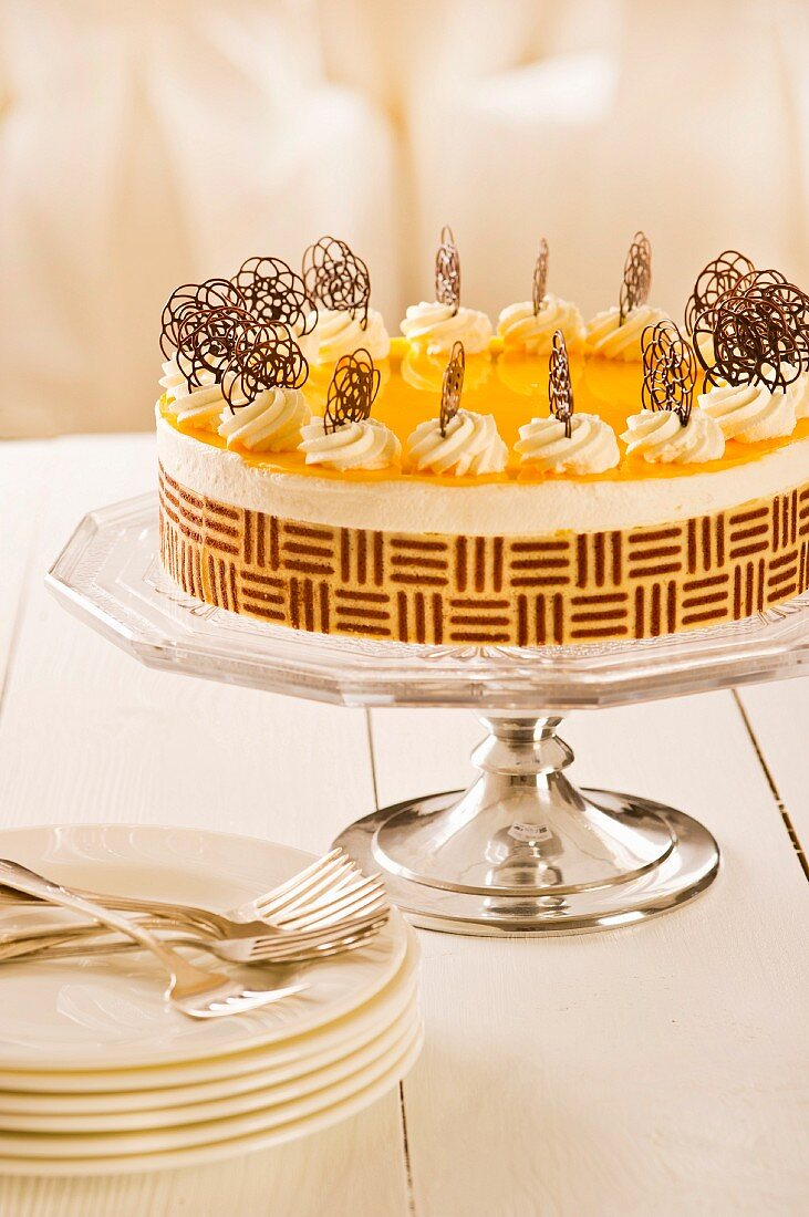 Egg liqueur cake decorated with cream and chocolate flowers