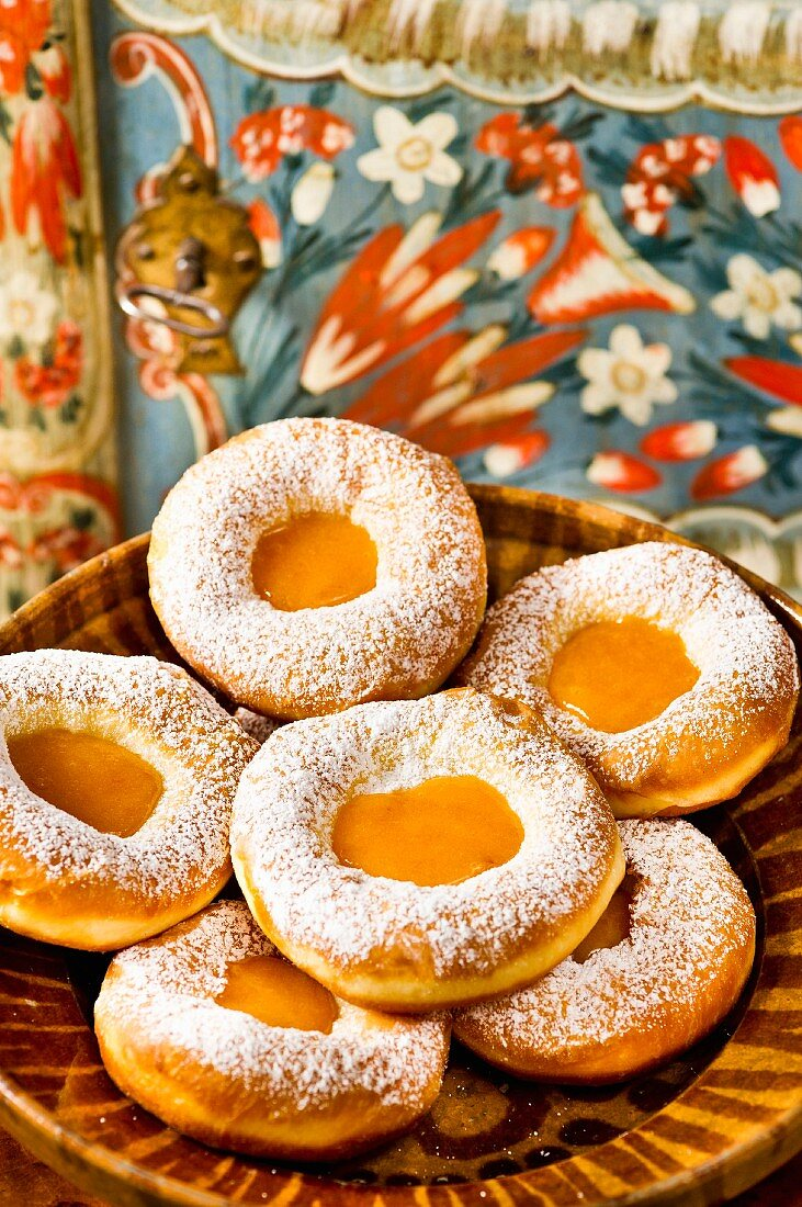 Doughnuts with marmalade jam and icing sugar