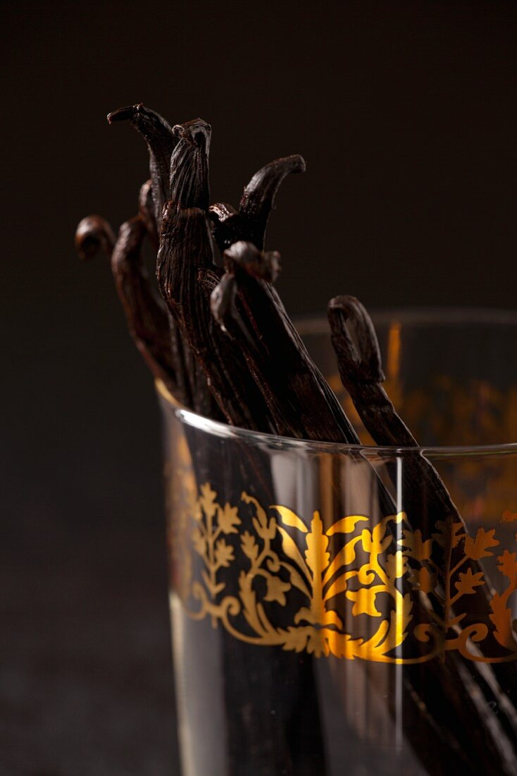 Vanilla pods in an Oriental glass