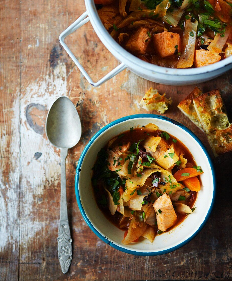 Fish soup with cabbage, root vegetables and onions