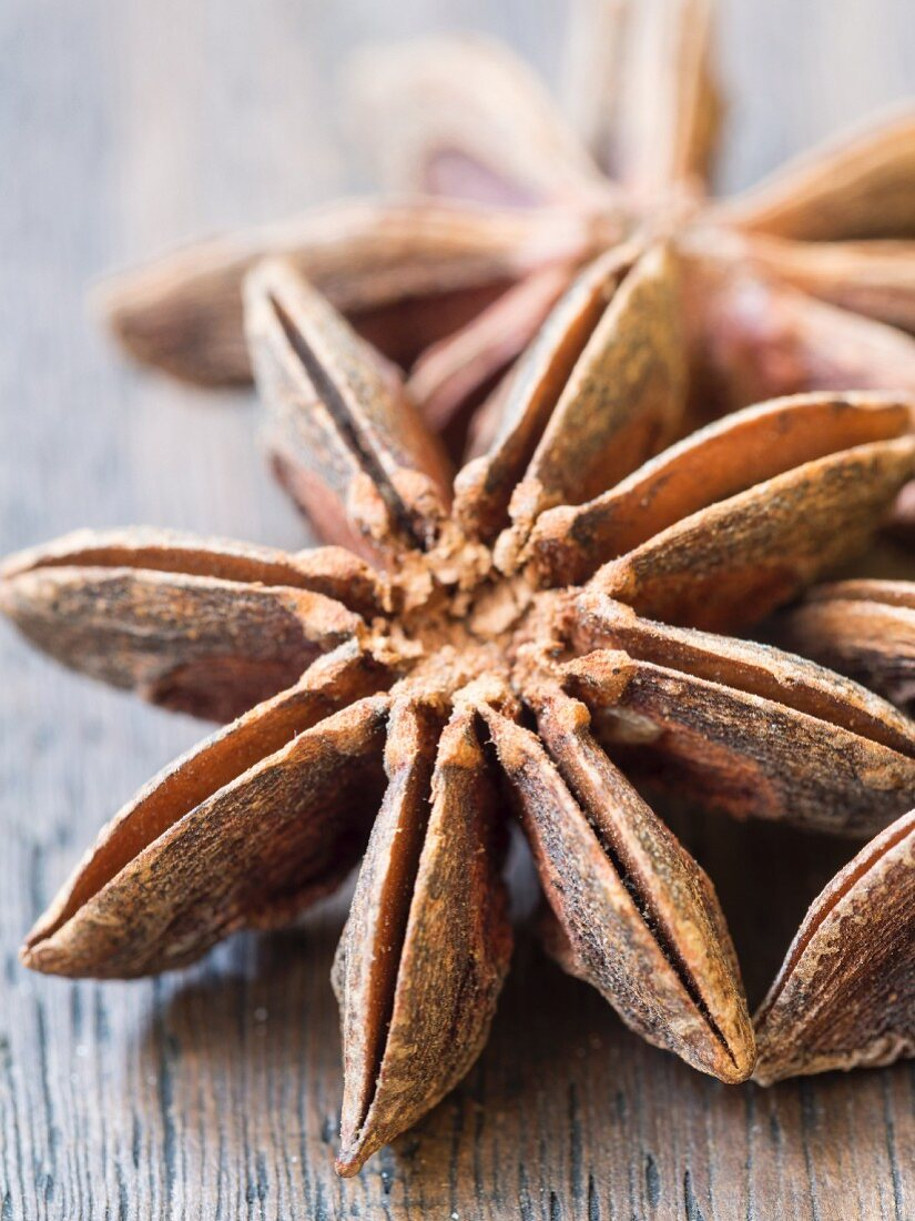 Star anise on a wooden surface (close-up)