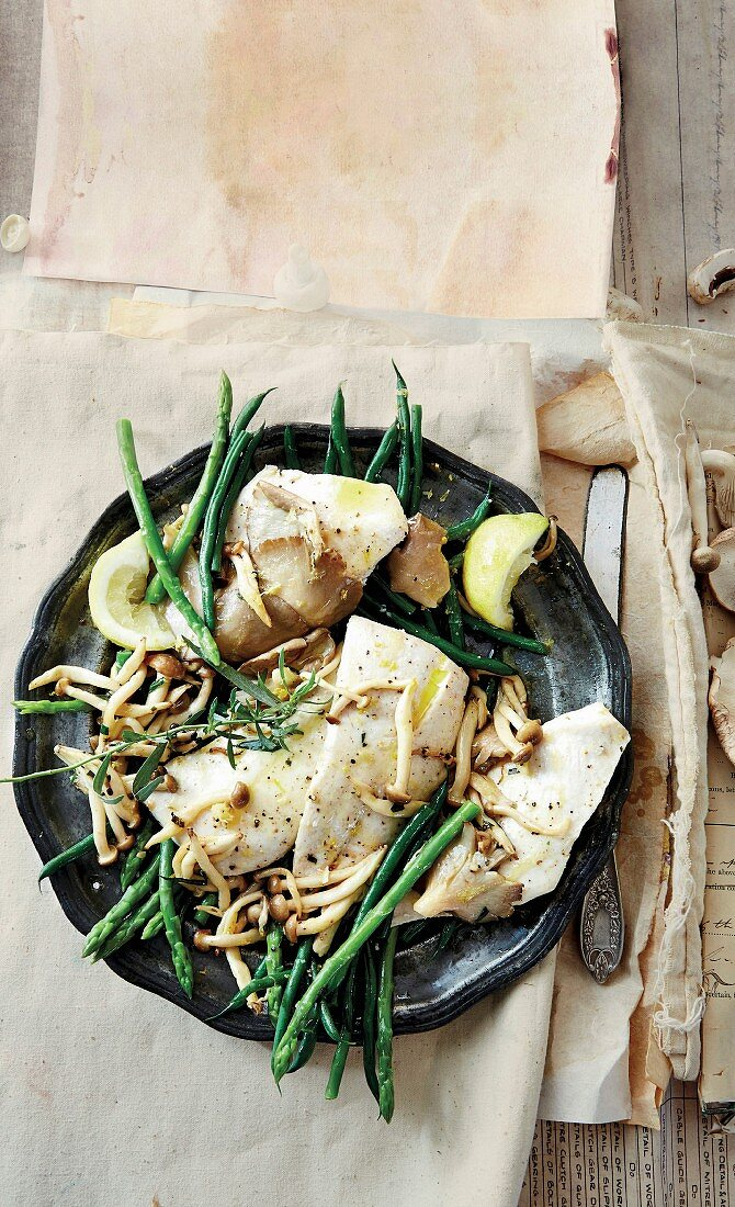 Grilled fish with mushrooms and tarragon butter
