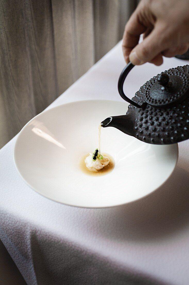 Raw squid strips with Thai broth in 'Le Cerf', Lake Geneva, Switzerland