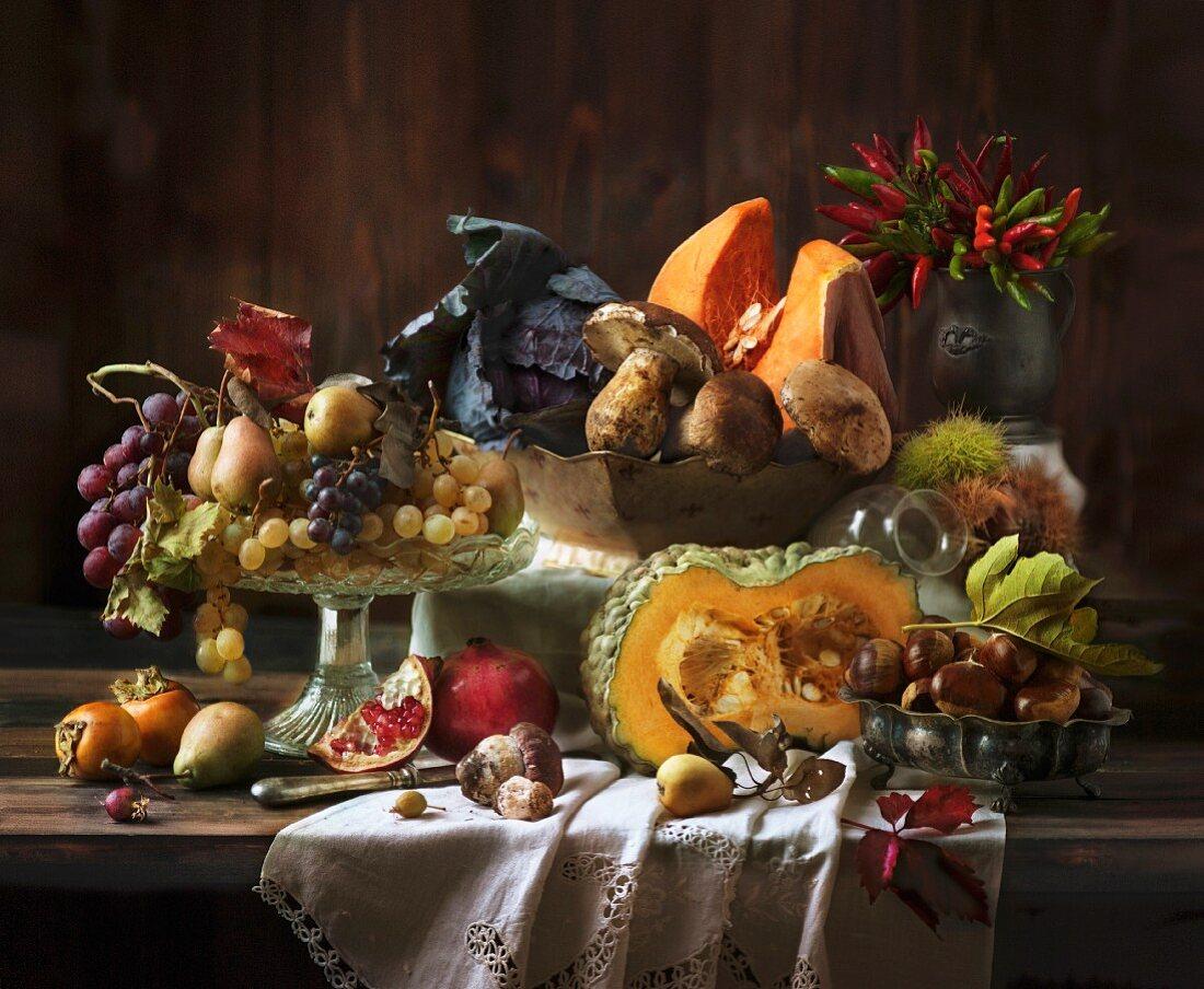 An autumnal arrangement featuring vegetables, mushrooms and fruit