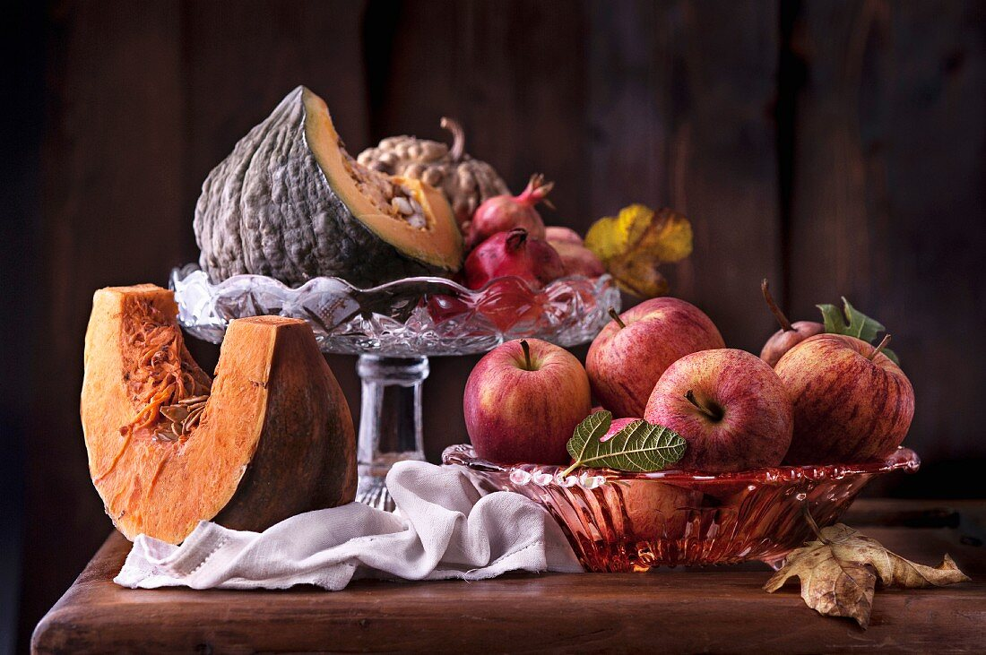 An autumnal arrangement featuring pumpkins, apples and pomegranates